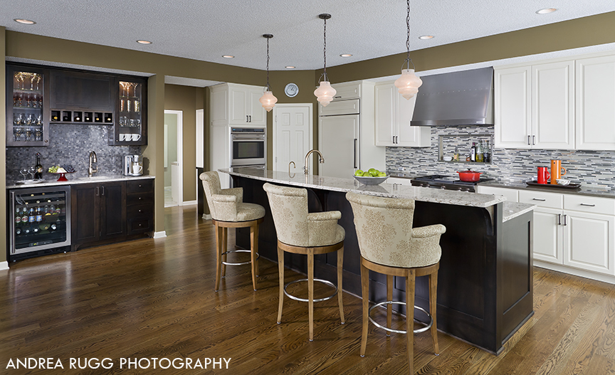 Large kitchen with dark wood island and bar area