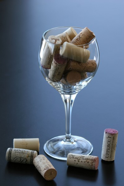 placecards - corks in glass on table